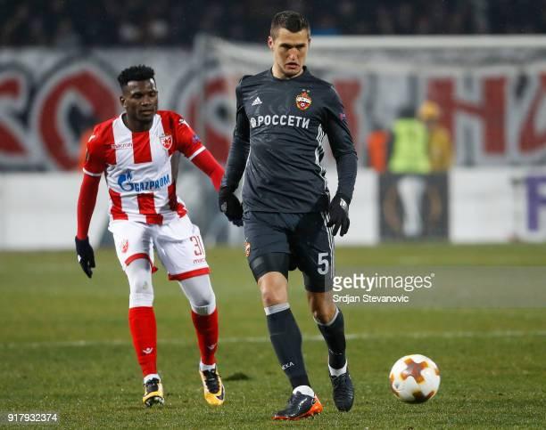 Viktor Vasin of CSKA Moscow in action against El Fardou Ben Nabouhane of Crvena Zvezda during the UEFA Europa League Round of 32 match between Crvena...