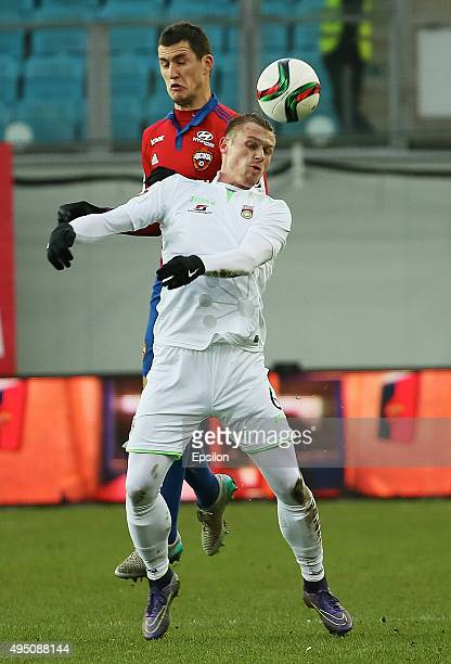Viktor Vasin of PFC CSKA Moscow challenged by Marvin Pourie of FC Ufa during the Russian Premier League match between PFC CSKA Moscow and FC Ufa at...