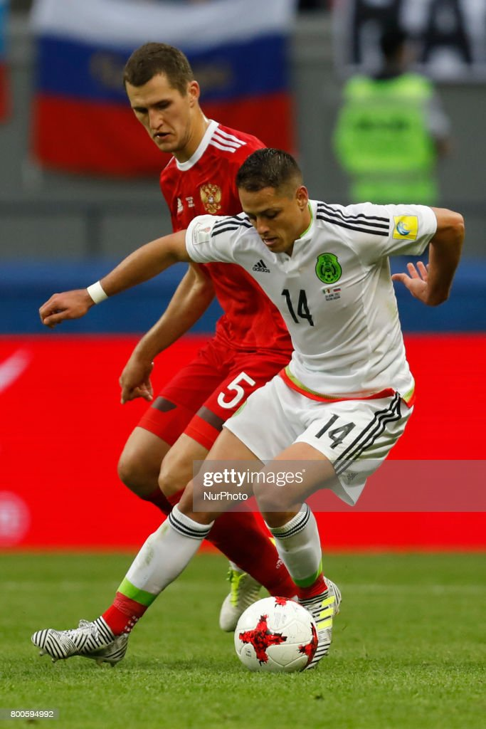 Viktor Vasin (L) of Russia national team and Javier Hernandez of Mexico national team vie for the ball during the Group A - FIFA Confederations Cup Russia 2017 match between Russia and Mexico at Kazan Arena on June 24, 2017 in Kazan, Russia.