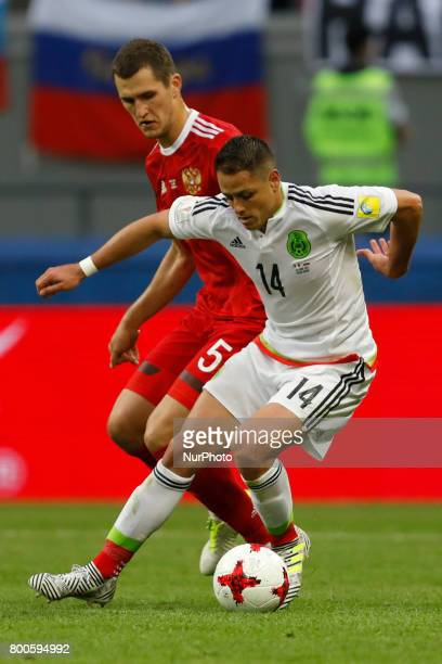 Viktor Vasin of Russia national team and Javier Hernandez of Mexico national team vie for the ball during the Group A FIFA Confederations Cup Russia...
