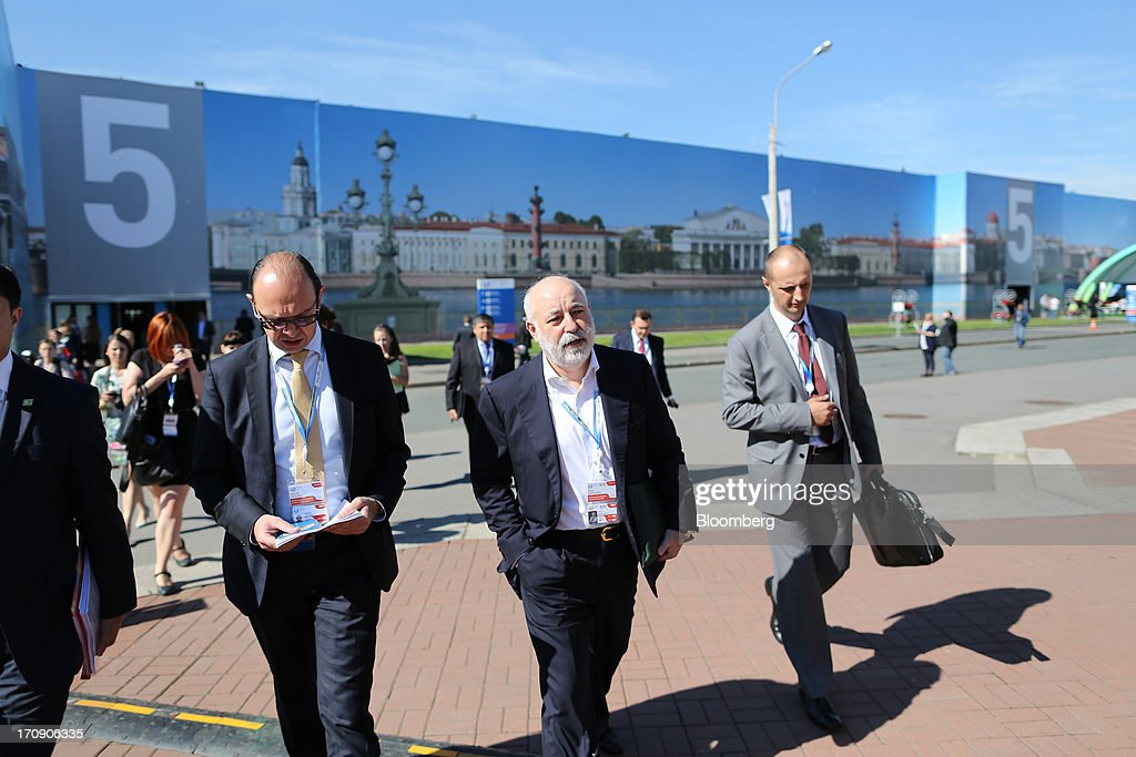 Viktor Vekselberg, Russian billionaire, center, arrives for a news conference on the opening day of the St. Petersburg International Economic Forum 2013 (SPIEF) in St. Petersburg, Russia, on Thursday, June 20, 2013. Russian consumer spending probably eased and investment shrank at the fastest pace since 2011, adding to evidence the $2 trillion economy is stalling. Photographer: Andrey Rudakov/Bloomberg via Getty Images
