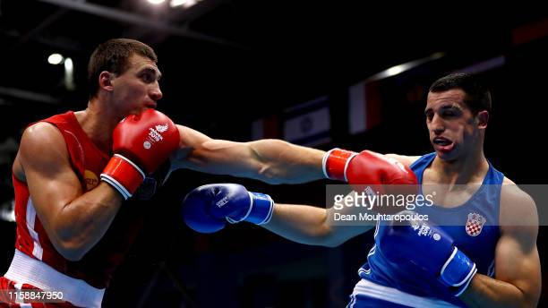 Viktor Vykhryst of Ukraine and Marko Milun of Croatia compete in the Boxing Men's Super Heavyweight 91kg SemiFinal bout during Day 8 of the 2nd...