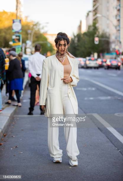 Viktoria is seen wearing white blazer, pants, beige cropped top, scarf, sneaker during About You Fashion Week on September 14, 2021 in Berlin,...
