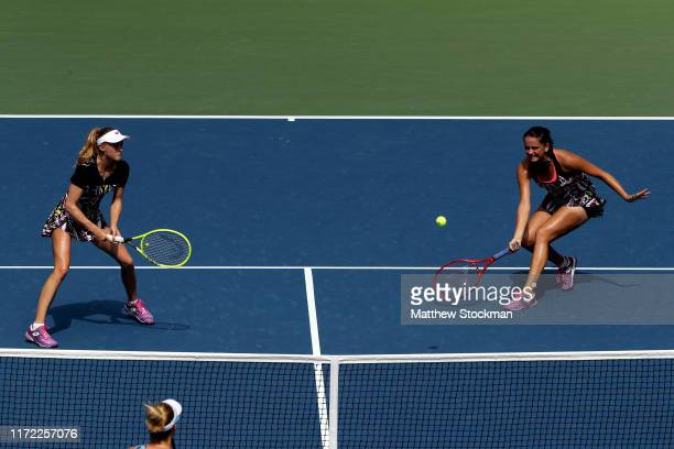 Viktoria Kuzmova of Slovakia and Aliaksandra Sasnovich of Belarus in action during their Women's Doubles quarterfinal match against Gabriela...