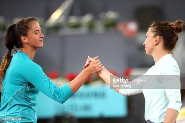 Viktoria Kuzmova of Slovakia congratulates opponent Simona Halep of Romania during day five of the Mutua Madrid Open at La Caja Magica on May 08 2019...