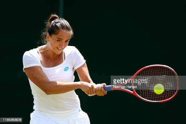 Viktoria Kuzmova of Slovakia plays a backhand during the Ladies' Singles first round match against Polona Hercog of Slovenia during Day one of The...