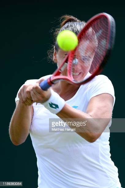 Viktoria Kuzmova of Slovakia plays a backhand in her Ladies' Singles first round match against Polona Hercog of Slovenia during Day one of The...