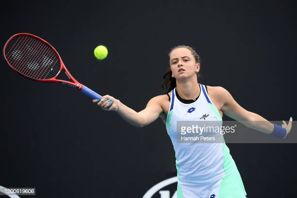 Viktoria Kuzmova of Slovakia plays a forehand during her Women's Singles first round match against Julia Goerges of Germany on day one of the 2020...