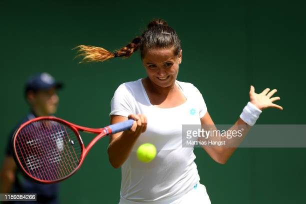 Viktoria Kuzmova of Slovakia plays a forehand during the Ladies' Singles first round match against Polona Hercog of Slovenia during Day one of The...