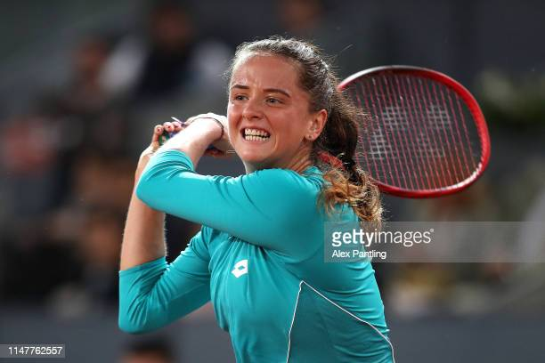 Viktoria Kuzmova of Slovakia returns the ball in her match against Simona Halep of Romania during day five of the Mutua Madrid Open at La Caja Magica...