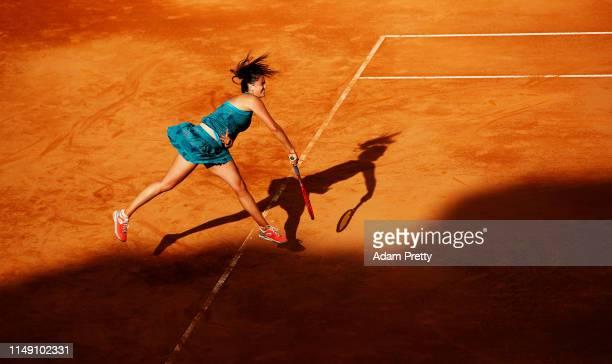 Viktoria Kuzmova of Slovakia serves to Ashleigh Barty of Australia during their match during day three of the International BNL d'Italia at Foro...