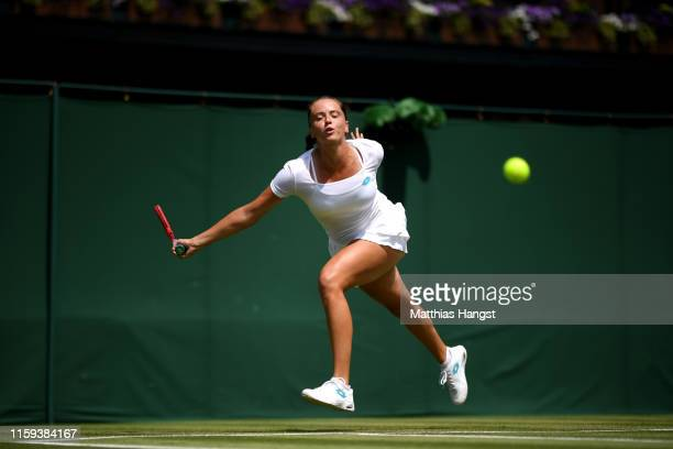 Viktoria Kuzmova of Slovakia stretches to play a shot during the Ladies' Singles first round match against Polona Hercog of Slovenia during Day one...