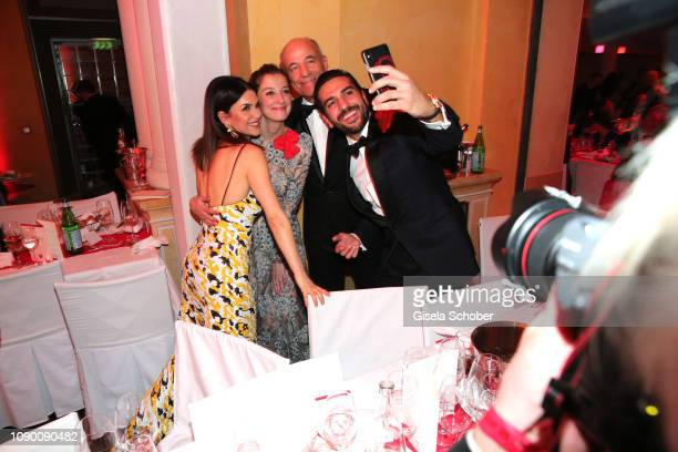 Viktoria Lauterbach Alexandra Maria Lara Heiner Lauterbach Elyas M'Barek take a selfie during the 46th German Film Ball party at Hotel Bayerischer...