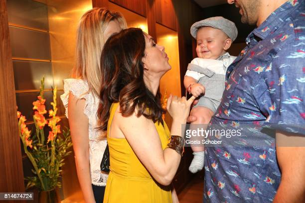 Viktoria Lauterbach and baby Elon Bozic during the summer cocktail and Mizu Onsen SPA Opening at Hotel BachmairWeissach on July 14 2017 in...