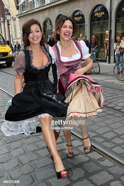 Viktoria Lauterbach wearing a dirndl by Lola Paltinger and her sister Najat Skaf during the 'Fruehstueck bei Tiffany' at Tiffany Store ahead of the...