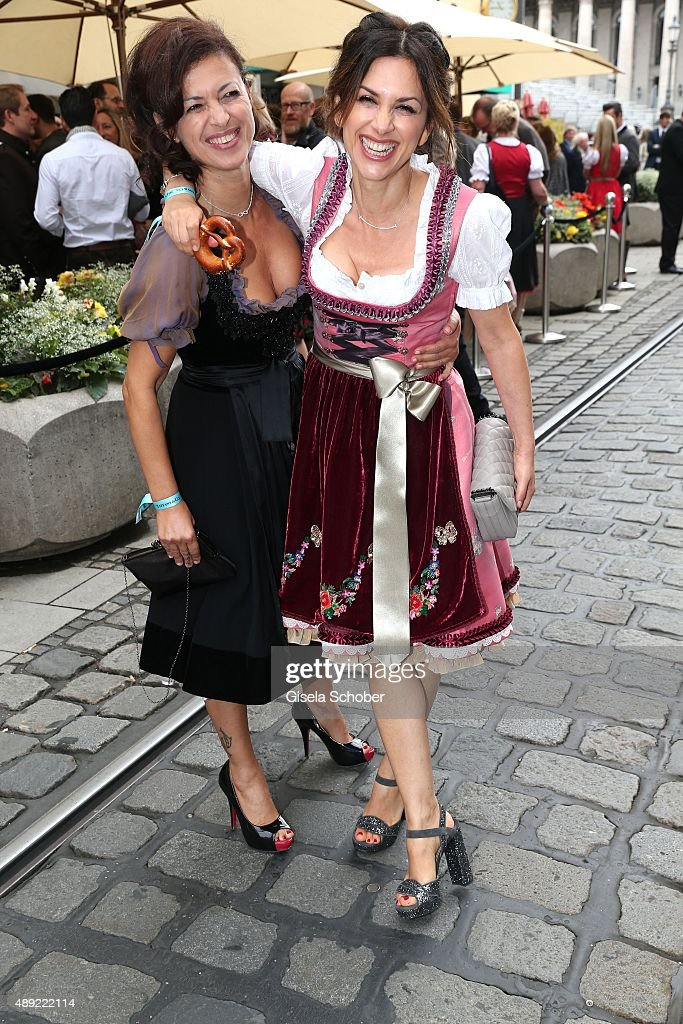 Viktoria Lauterbach wearing a dirndl by Lola Paltinger and her sister Najat Skaf (L) during the 'Fruehstueck bei Tiffany' at Tiffany Store ahead of the Oktoberfest 2015 on September 19, 2015 in Munich, Germany.