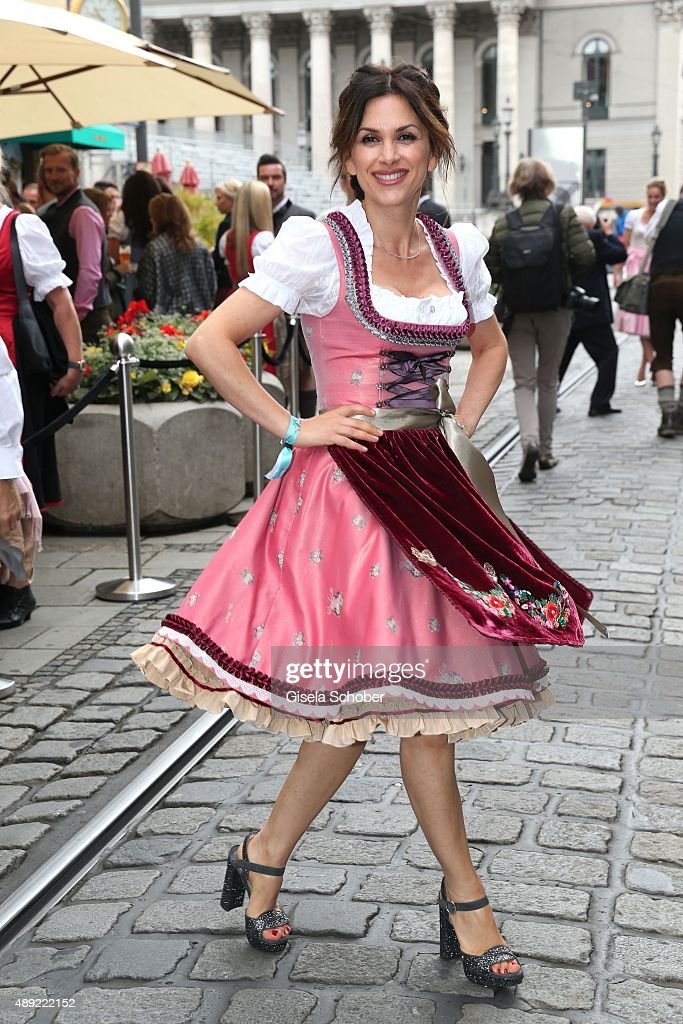 Viktoria Lauterbach wearing a dirndl by Lola Paltinger during the 'Fruehstueck bei Tiffany' at Tiffany Store ahead of the Oktoberfest 2015 on September 19, 2015 in Munich, Germany.