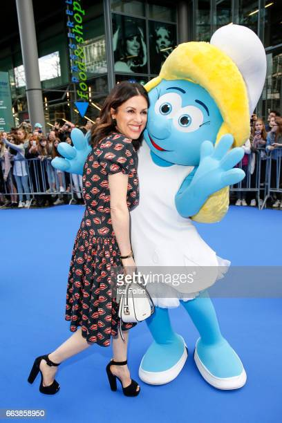 Viktoria Lauterbach with smurf 'Schlumpfine' during the 'Die Schluempfe Das verlorene Dorf' premiere at Sony Centre on April 2 2017 in Berlin Germany