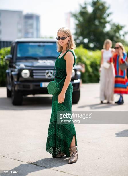 Viktoria Lykke wearing green dress is seen outside Lana Mueller during the Berlin Fashion Week July 2018 on July 5 2018 in Berlin Germany