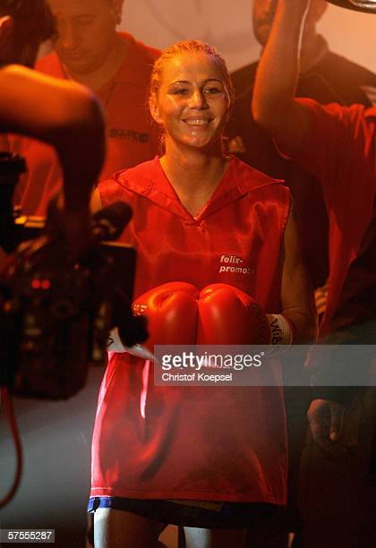 Viktoria Milo walks to the ring during the WIBF Women flyweight world championship fight between Regina Halmich of Germany and Viktoria Milo of...