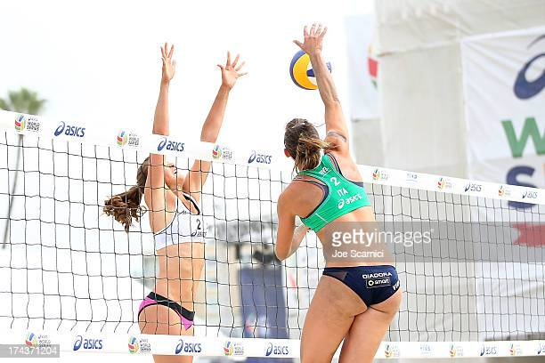 Viktoria Orsi Toth of Italy spikes over Taylor Pischke of Canada during the round of pool play at the ASICS World Series of Beach Volleyball - Day 3...
