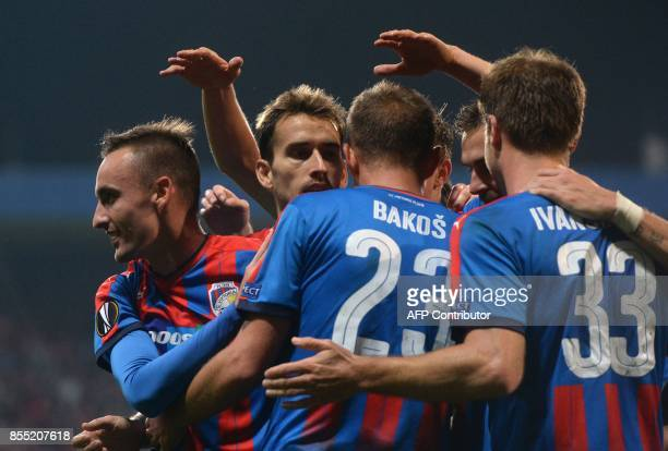 Viktoria Pilsen's players celebrate after scoring during the UEFA Europa League group G football match between FC Viktoria Plzen and Hapoel...
