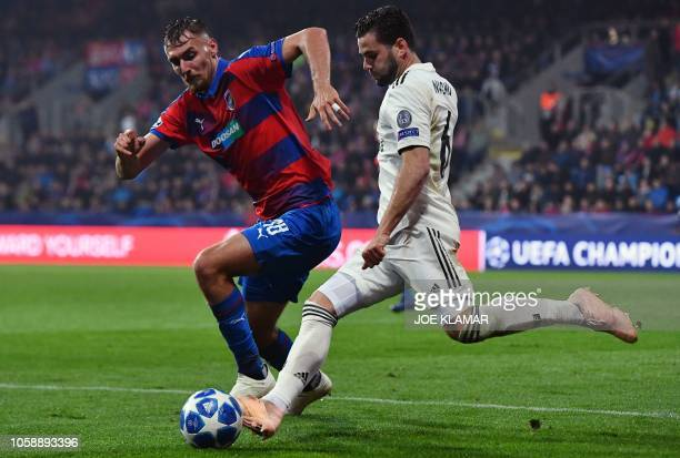 Viktoria Plzen's Czech forward Tomas Chory and Real Madrid's Spanish defender Nacho Fernandez vie for the ball during the UEFA Champions League group...