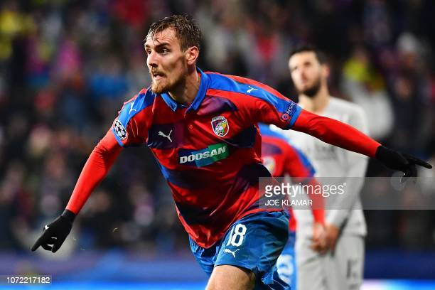 Viktoria Plzen's Czech forward Tomas Chory celebrates scoring during the UEFA Champions League group G football match between FC Victoria Plzen and...