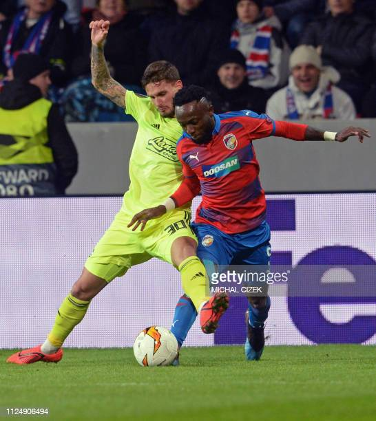 Viktoria Plzen's Joel Ngandu Kayamba and Dinamo Zagreb's Peter Stojanovic vie for the ball during the UEFA Europa League round of 32, first-leg...