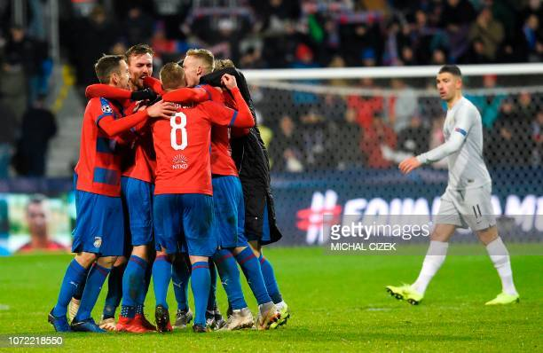 Viktoria Plzen's players celebrate after the UEFA Champions League group G football match between FC Victoria Plzen and AS Roma in Plzen, on December...