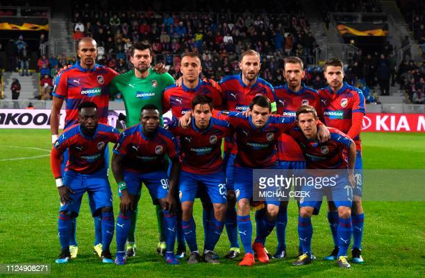Viktoria Plzen's players players pose for the team photo prior to the UEFA Europa League round of 32, first-leg football match between Viktoria Plzen...