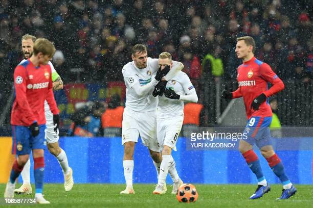 Viktoria Plzen's Slovak midfielder Roman Prochazka celebrates with teammates after scoring a goal during the UEFA Champions League group G football...