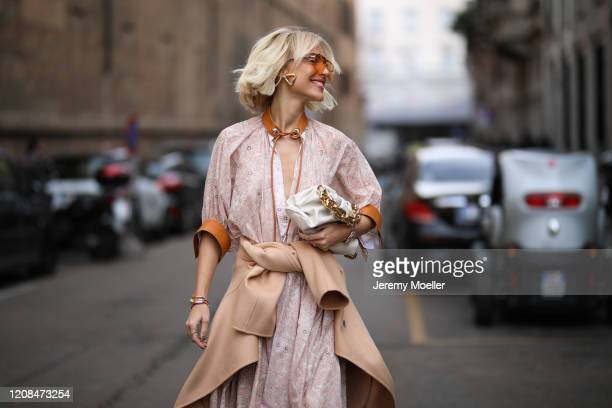 Viktoria Rader is seen wearing a Bottega Veneta bag and heels before Sportmax during Milan Fashion Week Fall/Winter 20202021 on February 21 2020 in...