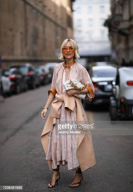 Viktoria Rader is seen wearing a Bottega Veneta bag and heels before Sportmax during Milan Fashion Week Fall/Winter 2020-2021 on February 21, 2020 in...
