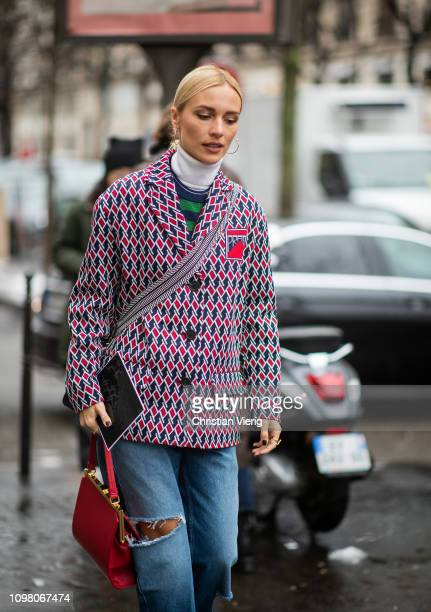 Viktoria Rader is seen wearing ripped denim jeans blazer jacket with pattern turtleneck red bag outside Stephane Rolland during Haute Couture Spring...