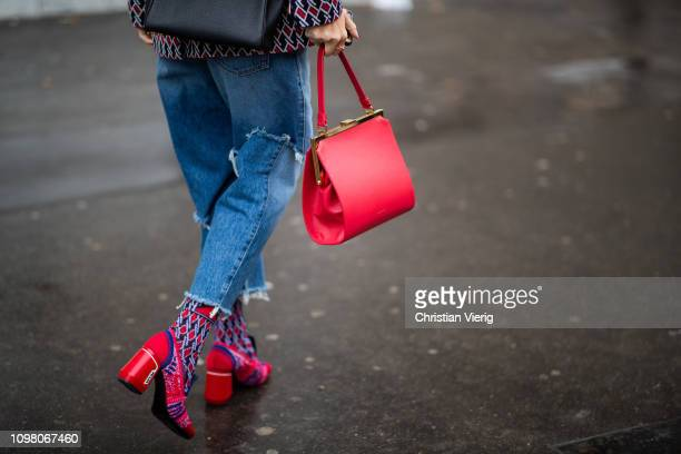 Viktoria Rader is seen wearing ripped denim jeans red bag shoes socks outside Stephane Rolland during Haute Couture Spring Summer 2019 Day Two on...