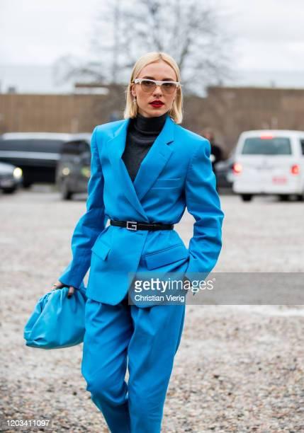 Viktoria Rader seen wearing turtleneck, blue blazer and coat, Bottega bag outside Baum und Pferdgarten during Copenhagen Fashion Week Autumn/Winter...