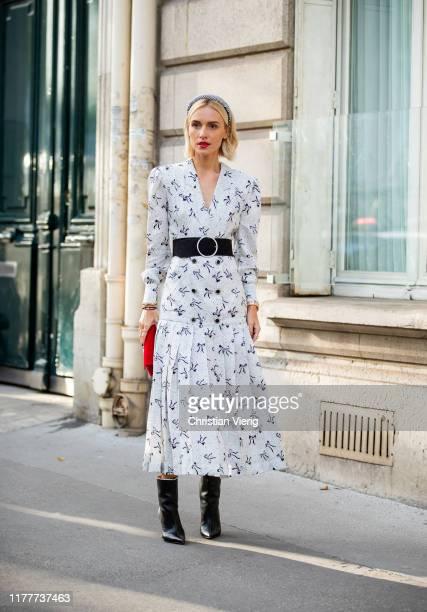 Viktoria Rader seen wearing white dress with print black belt outside Alessandra Rich during Paris Fashion Week Womenswear Spring Summer 2020 on...