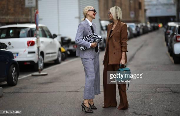 Viktoria Rader wearing a Bottega Veneta pouch and heels and a Max Mara full look and Lisa Hahnbück outside Max Mara during Milan Fashion Week...