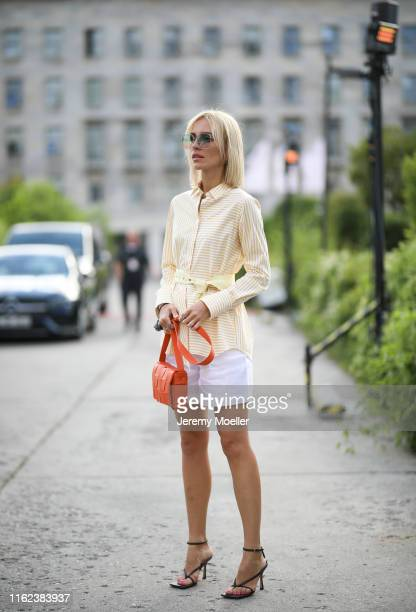 Viktoria Rader wearing Bottega Veneta bag and Riani look on July 03 2019 in Berlin Germany