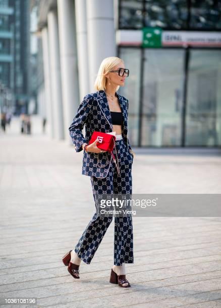 Viktoria Rader wearing glasses Gucci suit cropped top heels socks is seen outside Alberta Ferretti during Milan Fashion Week Spring/Summer 2019 on...