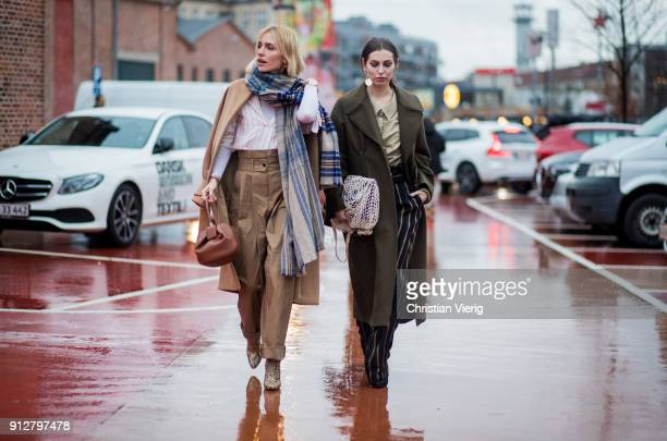 Viktoria Rader wearing high waisted pants trench coat Acne scarf and Masha Sedgwick outside Freya Dalsjo during the Copenhagen Fashion Week...