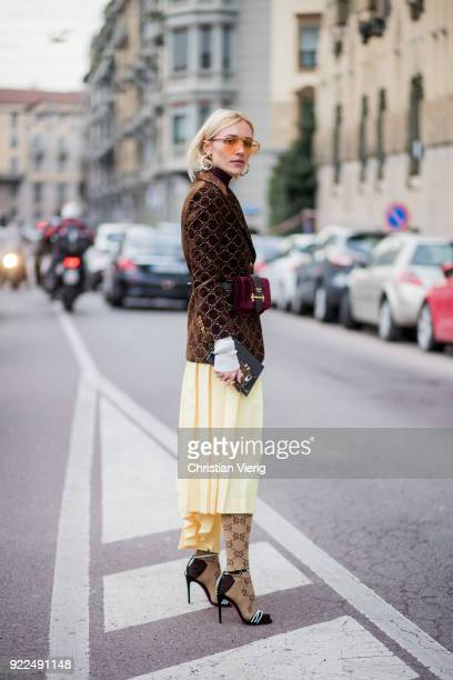 Viktoria Rader wearing jacket Prada bag yellow skirt Gucci stockings heels seen outside Alberta Ferretti during Milan Fashion Week Fall/Winter...