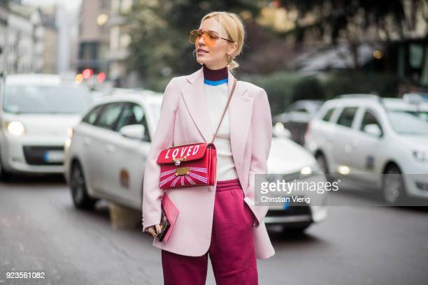 Viktoria Rader wearing jogger pants heels seen outside Blumarine during Milan Fashion Week Fall/Winter 2018/19 on February 23 2018 in Milan Italy