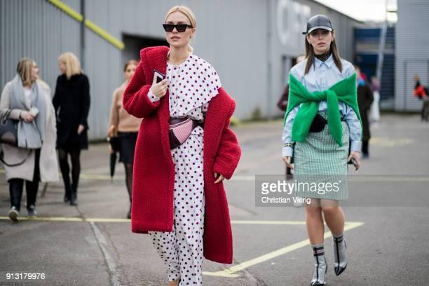 Viktoria Rader wearing Miu Miuc belt bag red coat and Masha Sedgwick outside Designers Remix during the Copenhagen Fashion Week Autumn/Winter 18 on...