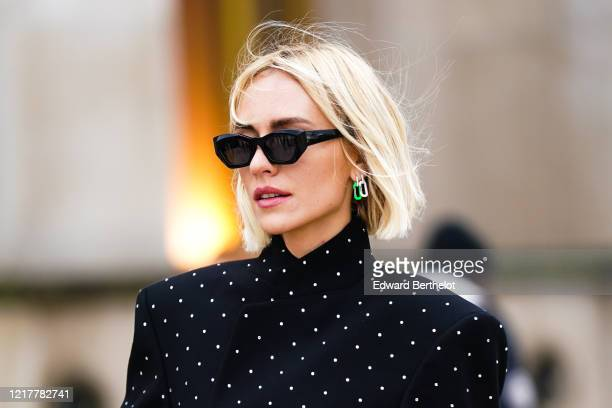 Viktoria Rader wears earrings, sunglasses, a black jacket with printed white polka dots, outside Ann Demeulemeester, during Paris Fashion Week -...
