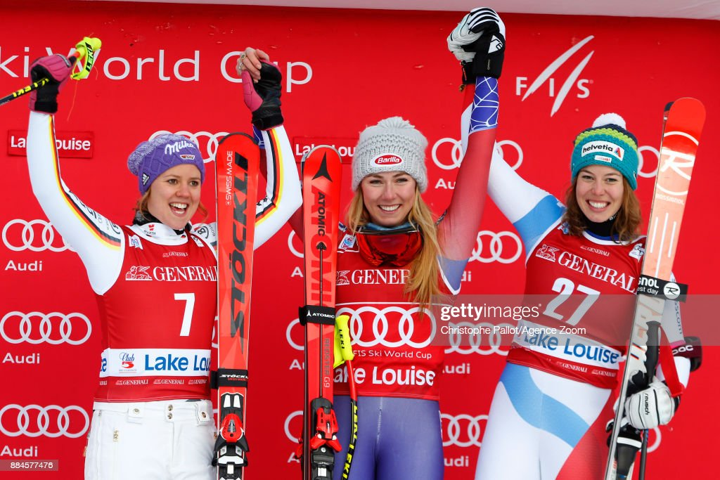 Viktoria Rebensburg of Germany takes 2nd place, Mikaela Shiffrin of USA takes 1st place, Michelle Gisin of Switzerland takes 3rd place during the Audi FIS Alpine Ski World Cup Women's Downhill on December 2, 2017 in Lake Louise, Canada.