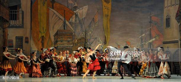 Viktoria Tereshkina as Kitri and Kimin Kim as Basilio with artists of the company in The Mariinsky Ballet's production of Marius Petipa and Aleksandr...
