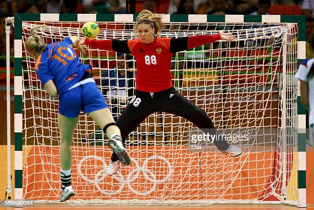 Viktoriia Kalinina of Russia blocks a shot by Danick Snelder of Netherlands in the first half on Day 9 of the Rio 2016 Olympic Games at the Future...