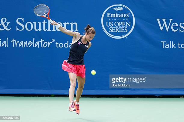 Viktorija Golubic of Switzerland hits a return to Lauren Davis of the United States during their qualifying match on Day 1 of the Western Southern...
